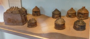 Clay hut models for bones or ashes of deceased